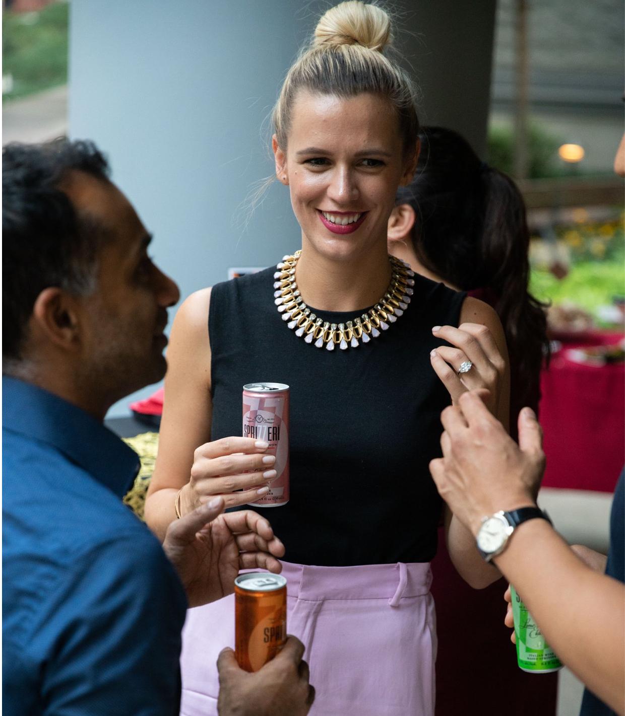 One Sixty Madison lifestyle Woman Drinking a soda